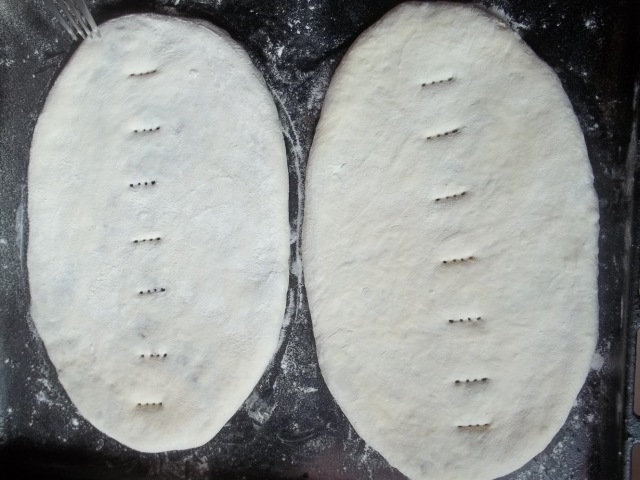 Pricking the Lobiani before baking - Copy