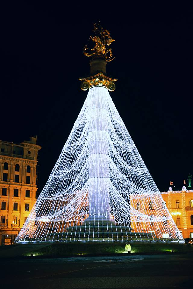 The Freedom Monument decorated with Christmas lights