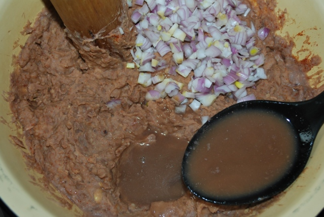 Adding chopped onions and lobio water - Copy