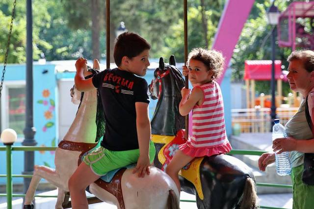 Children affected by the deadly flood in Tbilisi were treated to rides at Mushtaidi Park