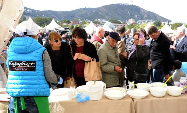 Visitors tasting cheese at the Caucasian Cheese 2015 festival in Rike Park
