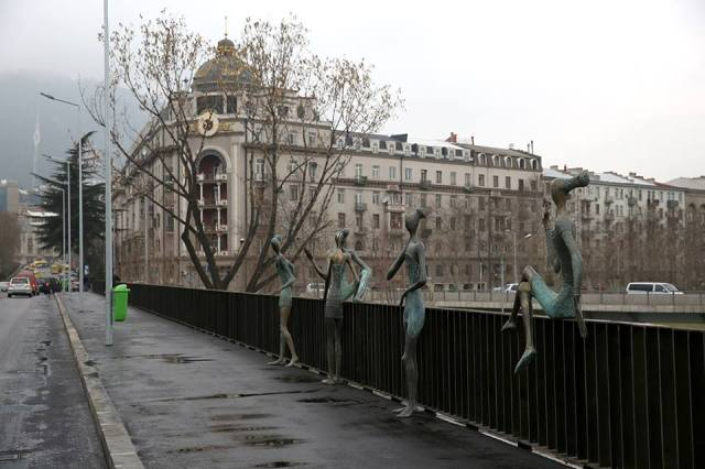 Bronze figures on the Baratashvili Bridge over the Mtkvari River in Tbilisi